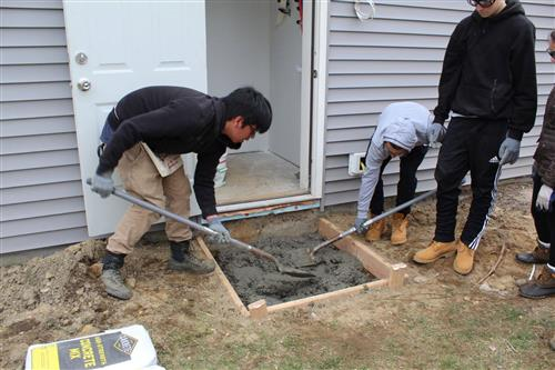 Newfield High School DECA, General Organization, and Leaders' Club students participate in Habitat for Humanity