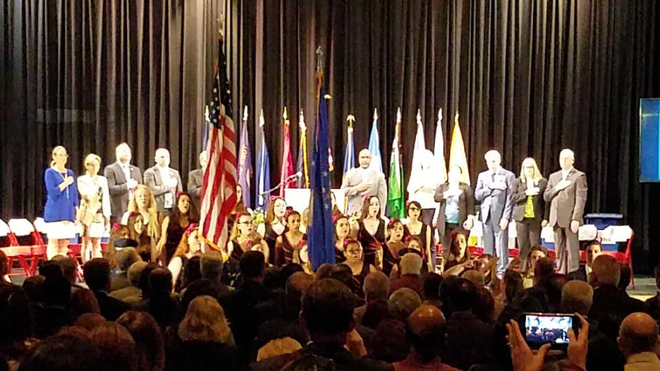 NHS Girl's Ensemble sang the National Anthem at County Executive Bellone's State of the County Address